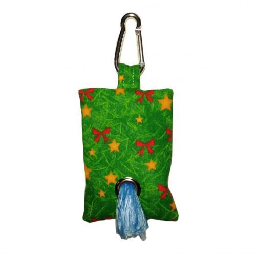 red bow on green christmas tree poop bag dispenser