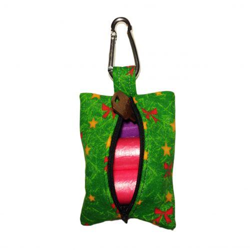 red bow on green christmas tree poop bag dispenser - back open