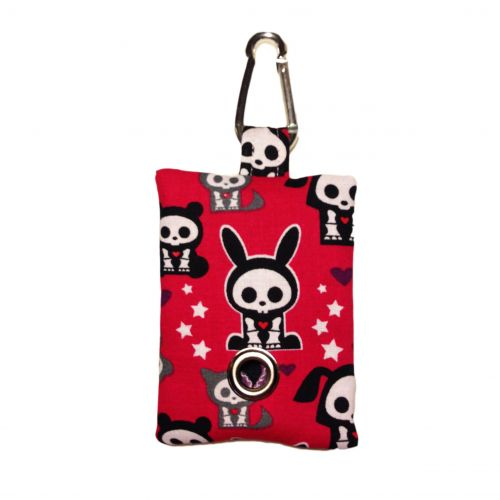 skelanimals on red poop bag dispenser - front