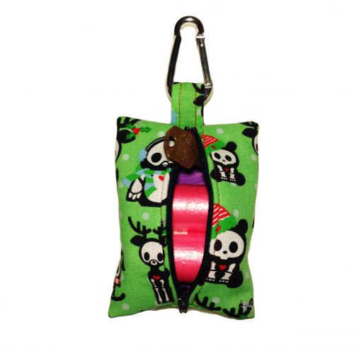 christmas skelanimals on green poop bag dispenser - back open