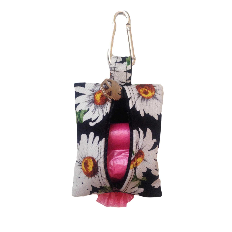 White Daisy Flower On Black Dog Poop Bag Dispenser